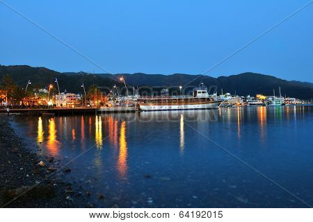 MARMARIS, TURKEY - APRIL 2, 2014: Boats in the bay in evening. Boat trips on the Marmaris bay is lovely leisure activity for tourists