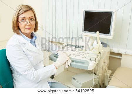 Successful obstetrician sitting in her room in clinic