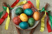 stock photo of flogging  - View of Czech Easter rods with painted eggs - JPG