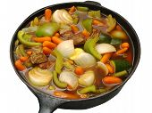 image of stew pot  - Beef stew cooking in an iron skillet on a white background - JPG