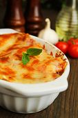 stock photo of lasagna  - Fresh lasagna with basil ready to eat - JPG