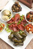 stock photo of antipasto  - Delicious freshly prepared antipasto mezze platter cosisting of a variety of mediterranean foods - JPG