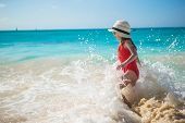 foto of children beach  - Cute little girl in hat at beach during summer vacation - JPG