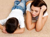 picture of disobedient  - Photo of young mother and its disobedient guilty crying son lying on the floor - JPG