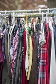 stock photo of thrift store  - clothes on a rack in a flea market  - JPG