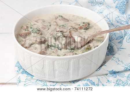 French veal ragout in white porcelain bowl. Blanquette de veau.