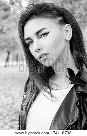 portrait of a beautiful girl in rock style with bright makeup black and white photo