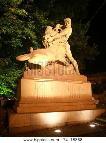 Man defeating lion  shown in  sculpture in Wroclaw, Poland