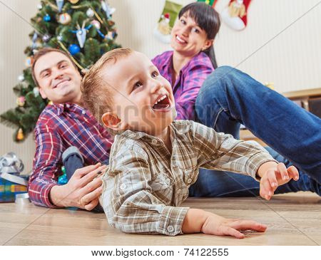 Happy Family At Home In Christmas Time