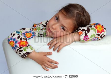 Girl resting on sofa