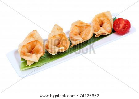 Chinese Dumplings On Plate , In A Row, Over White Background.