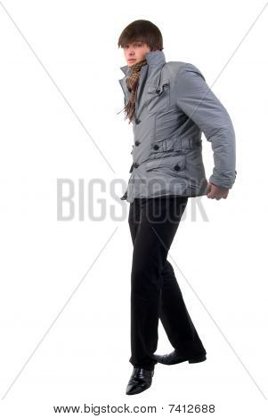 Walking Adult Fashion Boy. Side View. Studio Shoot Over White Background.