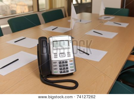 Phone on table in meeting room