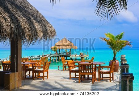 Cafe on the beach, ocean and sky