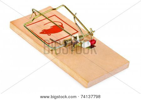 Mousetrap and pill isolated on white background