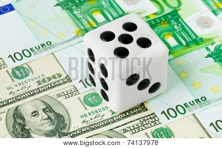 Dice on money background - business concept