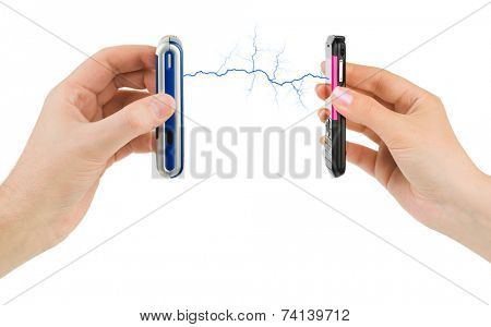 Hands and connected mobile phones isolated on white background