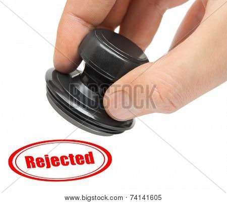 Hand and rubber stamp Rejected isolated on white background