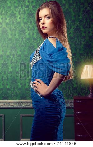 Sensula Woman In Blue Dress On Vintage Background