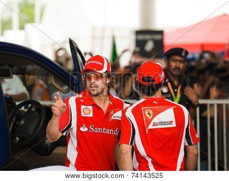 SEPANG, MALAYSIA - APRIL 10: Fernando Alonso and Felipe Massa (Ferrari) greet fans at the  autograph session on Formula 1 GP, April 10 2011, Sepang, Malaysia