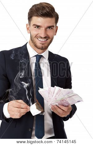 Wealthy Successful Businessman Burning Money
