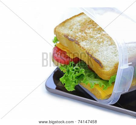 sandwich with cheese and tomato on digital tablet, for business lunch