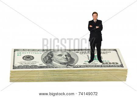 Businessman on money isolated on white background