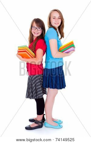 Happy Schoolgirls Holding Colorful Books