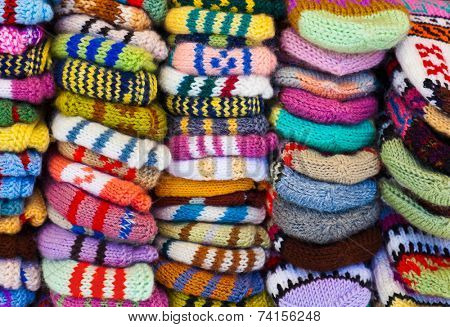 Pile of wool clothing - winter fashion background