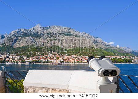 Binoculars and Makarska at Croatia - travel background