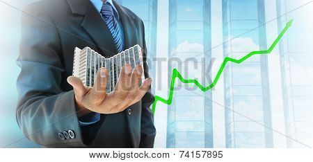 Businessman Hand Holding A Building