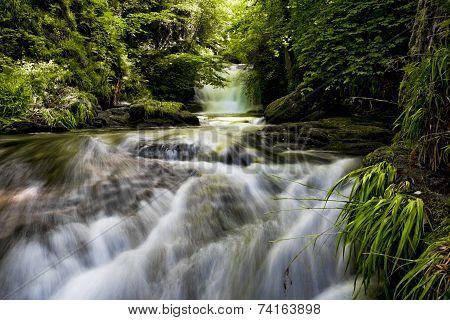 A waterfall at Watersmeet in Devon, UK.
