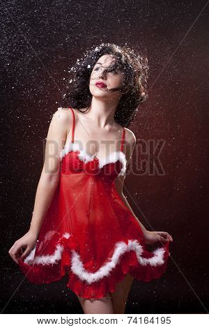 Sexy Santa helper. Red dress. Snowing