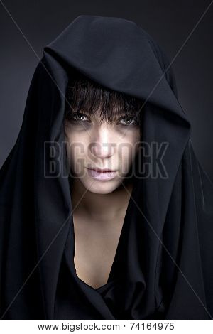 Scary woman with a pale face
