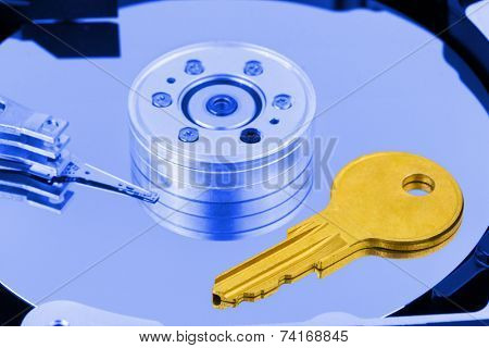 Key on computer harddrive - security concept background
