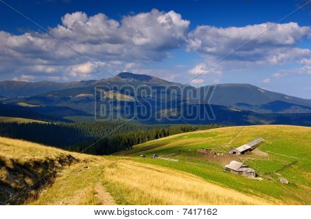 Summer Sunny Day And High-mountainous Farm