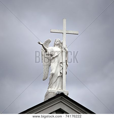 Statue Of The Archangel With A Cross
