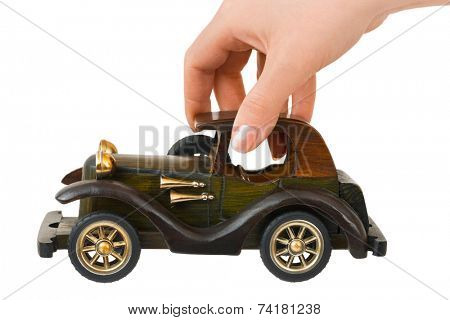 Hand and toy retro car isolated on white background