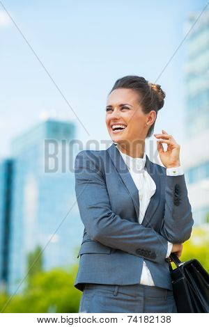 Smiling Business Woman With Briefcase In Office District Looking On Copy Space