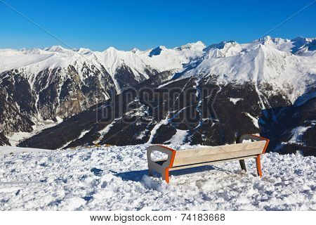 Bench at mountains ski resort Bad Gastein Austria - nature and sport background