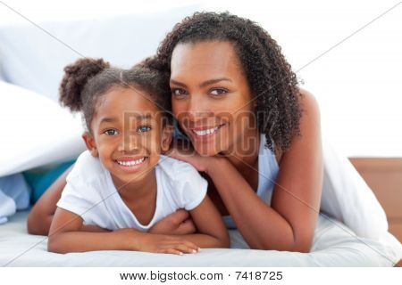 Affectionate Woman And Her Daughter Relaxing Lying Down On Bed