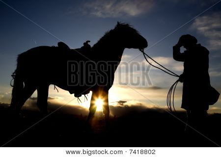 Man Holding Hat And Horse