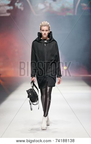 ZAGREB, CROATIA - OCTOBER 18, 2014: Fashion model wearing clothes designed by Marina Design and Marija Ivanovic bag on the 'Fashion.hr' fashion show