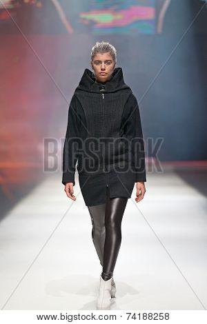 ZAGREB, CROATIA - OCTOBER 18,2014: Fashion model wearing clothes designed by Marina Design on the 'Fashion.hr' fashion show
