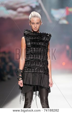ZAGREB, CROATIA - OCTOBER 18, 2014: Fashion model wearing clothes designed by Marina Design on the 'Fashion.hr' fashion show