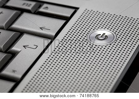 Closeup Of Silver Computer Laptop Selective Focus On Standby On Button Ideal For Technology Business