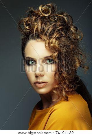 Stylish elegant lady's hairstyle. Young beautiful woman.