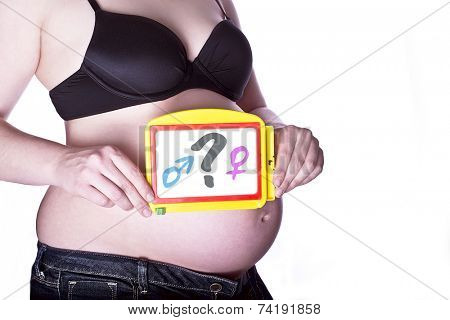 pregnant woman clothed in black bra and jeans holding a toy slate with a questionmark between gender symbols in front of her belly