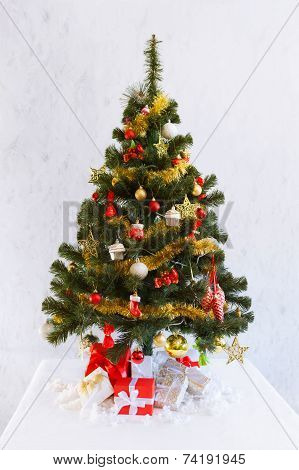 Christmas fir tree with decoration and presents