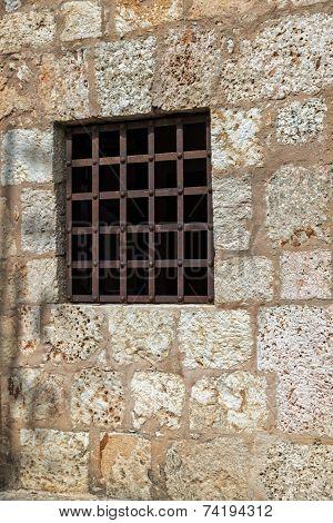 Window With Rusty Iron Bars, Stone Wall